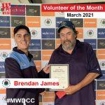 Brendan James receives his volunteer award from Ross Denny